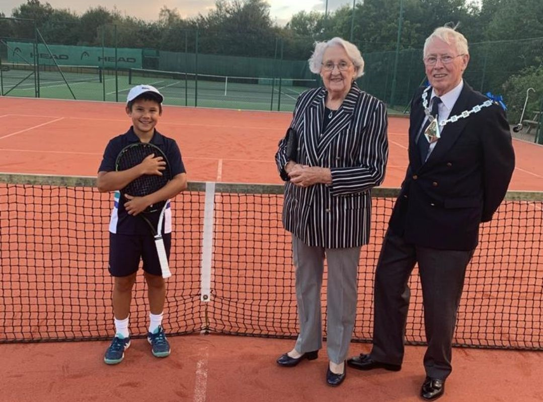 The Mayor and Mayoress of Ashford on a tennis court meeting Ben Gusic-Wan, who is a member of Wye Tennis Club