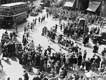 Crowds dancing in Oxford Circus, London on VJ Day.