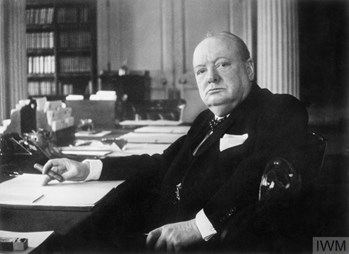 Winston Churchill at his seat in the Cabinet Room at 10 Downing Street, London.