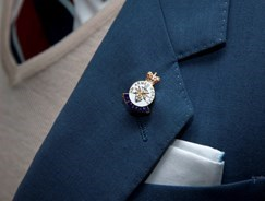 Close-up of a medal being worn on a jacket lapel