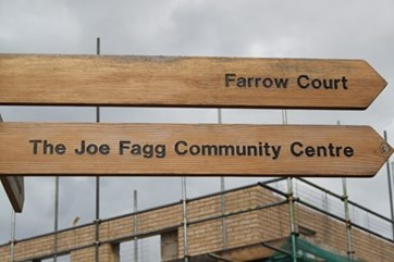 Sign pointing towards Farrow Court and The Joe Fagg Community Centre